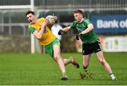 30 December 2018; Jason McGeeof Donegal in action against Ruairi Campbell of Queens University Belfast during the Bank of Ireland Dr McKenna Cup Round 1 match between Donegal and QUB at MacCumhaill Park in Ballybofey, Donegal. Photo by Oliver McVeigh/Sportsfile