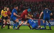 29 December 2018; Tadhg Beirne of Munster is tackled by  Rory O'Loughlin of Leinster during the Guinness PRO14 Round 12 match between Munster and Leinster at Thomond Park in Limerick. Photo by Diarmuid Greene/Sportsfile