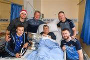 25 December 2018; Captain Stephen Cluxton, manager Jim Gavin, Jack McCaffrey, Eoin Murchan, patient Sean Lynch, from Sutton, Dublin, and the Sam Maguire Cup during the Dublin Football team visit to Beaumont Hospital in Dublin.  Photo by Ray McManus/Sportsfile