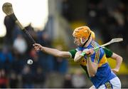 5 January 2019; Mark Kehoe of Tipperary has a shot on goal despite the attention of John Buckley of Kerry during the Co-Op Superstores Munster Hurling League 2019 match between Tipperary and Kerry at MacDonagh Park in Nenagh, Co. Tipperary. Photo by Eóin Noonan/Sportsfile