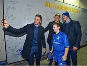 5 January 2019; Leinster players Jonathan Sexton, Garry Ringrose and Jordan Larmour with young supporter Daniel Hall, age 10, from Rathmines, Dublin, in 'Autograph Alley' prior to the Guinness PRO14 Round 13 match between Leinster and Ulster at the RDS Arena in Dublin. Photo by Seb Daly/Sportsfile