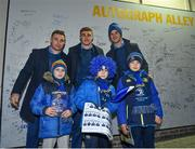 5 January 2019; Leinster players Jonathan Sexton, Garry Ringrose and Jordan Larmour with supporters, from left, Paul Corneliusson, age 9, Sam Casey, age 8, and Jack Casey, age 10, in 'Autograph Alley' prior to the Guinness PRO14 Round 13 match between Leinster and Ulster at the RDS Arena in Dublin. Photo by Seb Daly/Sportsfile