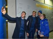 5 January 2019; Leinster players Jonathan Sexton, Garry Ringrose and Jordan Larmour with young supporter Holly Boylan, from Banagher, Co. Offaly, in 'Autograph Alley' prior to the Guinness PRO14 Round 13 match between Leinster and Ulster at the RDS Arena in Dublin. Photo by Seb Daly/Sportsfile