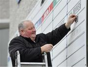 6 January 2019; Mick Cusack, from Waterford, updates the Non-Runners list prior to racing at Naas Racecourse in Kildare. Photo by Seb Daly/Sportsfile