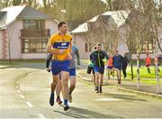 6 January 2019; Clare captain Gary Brennan leads his team-mates to the Gold Coast Resort pitch before the start of the McGrath Cup Semi-final match between Waterford and Clare at the Gold Coast Resort in Waterford. Photo by Matt Browne/Sportsfile
