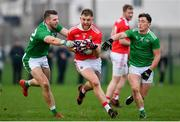 6 January 2019; Cillian O'Hanlon of Cork is tackled by Tommy Griffin, left, and Peter Nash of Limerick during the McGrath Cup Semi-final between Limerick and Cork at Mick Neville Park in Rathkeale, Co. Limerick. Photo by Ramsey Cardy/Sportsfile