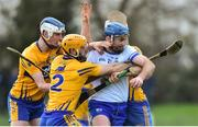 6 January 2019; Michael Walsh of Waterford in action against Diarmuid Ryan, Jason McCarthy and Aidan McCarthy of Clare during the Co-Op Superstores Munster Hurling League 2019 match between Waterford and Clare at Fraher Field in Waterford. Photo by Matt Browne/Sportsfile