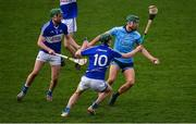 6 January 2019; Chris Crummey of Dublin in action against Paddy Purcell and Aaron Dunphy of Laois the Bord na Mona Walsh Cup Round 3 match between Laois and Dublin at O'Moore Park in Portlaoise, Laois. Photo by Brendan Moran/Sportsfile