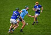 6 January 2019; Chris Crummey of Dublin in action against Aaron Dunphy, left, and Mark Kavanagh of Laois during the Bord na Mona Walsh Cup Round 3 match between Laois and Dublin at O'Moore Park in Portlaoise, Laois. Photo by Brendan Moran/Sportsfile
