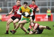 6 January 2019; Michael Langan of Donegal in action against Brendan McArdle, left, and Aaron McClements of Down during the Bank of Ireland Dr McKenna Cup Round 2 match between Down and Donegal at Pairc Esler, Newry, Co. Down. Photo by Oliver McVeigh/Sportsfile