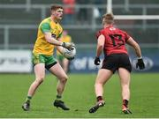 6 January 2019; Conor Morrison of Donegal in action against Jerome Johnston of Down during the Bank of Ireland Dr McKenna Cup Round 2 match between Down and Donegal at Pairc Esler, Newry, Co. Down. Photo by Oliver McVeigh/Sportsfile