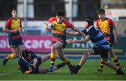 8 January 2019; Niall O'Halloran of St Fintan's High School is tackled by Finn Sunderman, right, and Ian Walsh of Newpark Comprehensive School during the Bank of Ireland Vinnie Murray Cup Round 1 match between Newpark Comprehensive and St Fintan's High School at Energia Park in Dublin. Photo by David Fitzgerald/Sportsfile