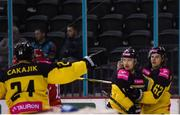 11 January 2019; Jesse Rohtla of GKS Katowice, centre, celebrates after scoring his side's second goal, with team-mates Janne Laakkonen, right, and Martin Cakajik during the IIHF Continental Cup Final match between GKS Katowice and Arlan Kokshetau at the SSE Arena in Belfast, Co Antrim. Photo by Eoin Smith/Sportsfile