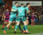 11 January 2019; Joey Carbery of Munster celebrates with team-mates Peter O'Mahony, left, and Rory Scannell, centre, after scoring his side's first try during the Heineken Champions Cup Pool 2 Round 5 match between Gloucester and Munster at Kingsholm Stadium in Gloucester, England. Photo by Seb Daly/Sportsfile