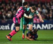 11 January 2019; Rory Scannell of Munster is tackled by Danny Cipriani, left, and Ed Slater of Gloucester during the Heineken Champions Cup Pool 2 Round 5 match between Gloucester and Munster at Kingsholm Stadium in Gloucester, England. Photo by Seb Daly/Sportsfile