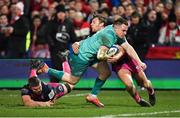 11 January 2019; Rory Scannell of Munster evades the tackle of Ed Slater, left, and Callum Braley of Gloucester on his way to scoring his side's second try during the Heineken Champions Cup Pool 2 Round 5 match between Gloucester and Munster at Kingsholm Stadium in Gloucester, England. Photo by Seb Daly/Sportsfile