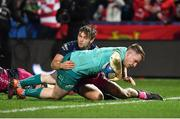11 January 2019; Rory Scannell of Munster dives over to score his side's second try, despite the tackle of Callum Braley of Gloucester, during the Heineken Champions Cup Pool 2 Round 5 match between Gloucester and Munster at Kingsholm Stadium in Gloucester, England. Photo by Seb Daly/Sportsfile