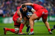 12 January 2019; Rory O'Loughlin of Leinster is tackled by Jerome Kaino, left, and Julien Marchand of Toulouse during the Heineken Champions Cup Pool 1 Round 5 match between Leinster and Toulouse at the RDS Arena in Dublin. Photo by Ramsey Cardy/Sportsfile