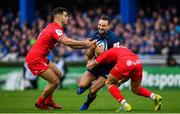 12 January 2019; Dave Kearney of Leinster is tackled by Sofiane Guitoune, left, and Romain Ntamack of Toulouse during the Heineken Champions Cup Pool 1 Round 5 match between Leinster and Toulouse at the RDS Arena in Dublin. Photo by Ramsey Cardy/Sportsfile