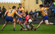 12 January 2019; James Fitzpatrick of Cork in action against Cillian Brennan, Gordon Kelly, and Aaron Fitzgerald of Clare during the McGrath Cup Final match between Cork and Clare at Hennessy Park in Miltown Malbay, Co. Clare. Photo by Diarmuid Greene/Sportsfile