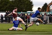 12 January 2019; Callum McCormack of Westmeath shoots to score his side's second goal despite the attentions of Iarla O'Sullivan, left, and Barry McKeon of Longford during the Bord na Mona O'Byrne Cup semi-final match between Westmeath and Longford at Downs GAA Club in Westmeath. Photo by Sam Barnes/Sportsfile