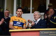 12 January 2019; Clare captain Gary Brennan is presented with the McGrath cup by Munster Council Chairman Jerry O'Sullivan after the McGrath Cup Final match between Cork and Clare at Hennessy Park in Miltown Malbay, Co. Clare. Photo by Diarmuid Greene/Sportsfile