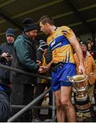 12 January 2019; Clare captain Gary Brennan is greeted by a supporter as he carries the cup after the McGrath Cup Final match between Cork and Clare at Hennessy Park in Miltown Malbay, Co. Clare. Photo by Diarmuid Greene/Sportsfile