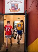 12 January 2019; Clare captain Gary Brennan makes his way into the Clare dressing room with the cup as Kevin O'Donovan of Cork returns to the Cork dressing room after the McGrath Cup Final match between Cork and Clare at Hennessy Park in Miltown Malbay, Co. Clare. Photo by Diarmuid Greene/Sportsfile