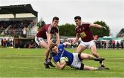 12 January 2019; Peter Hanley of Longford in action against Sam Duncan, left, and David Lynch of Westmeath during the Bord na Mona O'Byrne Cup semi-final match between Westmeath and Longford at Downs GAA Club in Westmeath. Photo by Sam Barnes/Sportsfile