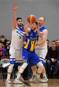 12 January 2019; Mike Garrow of UCD Marian in action against Matthew Jackson and Paddy McGaharan of Belfast Star during the Hula Hoops Men's Pat Duffy National Cup semi-final match between UCD Marian and Belfast Star at the Mardyke Arena UCC in Cork. Photo by Brendan Moran/Sportsfile