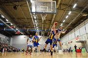 12 January 2019; Barry Drumm of UCD Marian is fouled by Conor Quinn of Belfast Star during the Hula Hoops Men's Pat Duffy National Cup semi-final match between UCD Marian and Belfast Star at the Mardyke Arena UCC in Cork.  Photo by Brendan Moran/Sportsfile