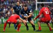 12 January 2019; Cian Healy of Leinster is tackled by Antoine Dupont, left, and Thomas Ramos of Toulouse during the Heineken Champions Cup Pool 1 Round 5 match between Leinster and Toulouse at the RDS Arena in Dublin. Photo by Ramsey Cardy/Sportsfile