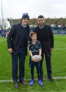 12 January 2019; Matchday mascot 8 year old Rian Alonso, from Harolds Cross, Dublin, with Lenster players Rob Kearney and Jonathan Sexton prior to the Heineken Champions Cup Pool 1 Round 5 match between Leinster and Toulouse at the RDS Arena in Dublin. Photo by Ramsey Cardy/Sportsfile