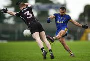13 January 2019; Donie Smith of Roscommon in action against Peter Laffey of Sligo during the Connacht FBD League semi-final match between Roscommon and Sligo at Dr. Hyde Park in Roscommon. Photo by David Fitzgerald/Sportsfile