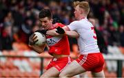 13 January 2019; Shane McGuigan of Derry in action against Hugh Pat McGeary of Tyrone during the Bank of Ireland Dr McKenna Cup semi-final match between Tyrone and Derry at the Athletic Grounds in Armagh. Photo by Sam Barnes/Sportsfile