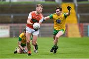 13 January 2019; Rian O'Neill of Armagh in action against Jamie Brennan of Donegal during the Bank of Ireland Dr McKenna Cup semi-final match between Donegal and Armagh at Healy Park in Tyrone. Photo by Oliver McVeigh/Sportsfile