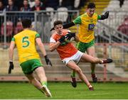 13 January 2019; Niall Grimley of Armagh in action against Michael Langan of Donegal during the Bank of Ireland Dr McKenna Cup semi-final match between Donegal and Armagh at Healy Park in Tyrone. Photo by Oliver McVeigh/Sportsfile