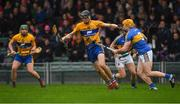 13 January 2019; Colin Guilfoyle of Clare, supported by team-mate Cathal McInerney, left, in action against Padraic Maher and Cathal Barrett, behind, of Tipperary during the Co-Op Superstores Munster Hurling League Final 2019 match between Clare and Tipperary at the Gaelic Grounds in Limerick. Photo by Piaras Ó Mídheach/Sportsfile