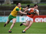 13 January 2019; Stephen Sheridan of Armagh in action against Jason McGee of Donegal during the Bank of Ireland Dr McKenna Cup semi-final match between Donegal and Armagh at Healy Park in Tyrone. Photo by Oliver McVeigh/Sportsfile