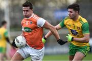 13 January 2019; Stefan Campbell of Armagh  in action against Brendan McCole of Donegal  during the Bank of Ireland Dr McKenna Cup semi-final match between Donegal and Armagh at Healy Park in Tyrone. Photo by Oliver McVeigh/Sportsfile