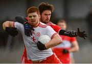 13 January 2019; Cathal McShane of Tyrone in action against Christopher McKaigue of Derry during the Bank of Ireland Dr McKenna Cup semi-final match between Tyrone and Derry at the Athletic Grounds in Armagh. Photo by Sam Barnes/Sportsfile