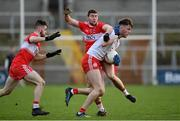 13 January 2019; Brian Kennedy of Tyrone in action against Ciaran McFaul, centre, and Eoghan Concannon of Derry during the Bank of Ireland Dr McKenna Cup semi-final match between Tyrone and Derry at the Athletic Grounds in Armagh. Photo by Sam Barnes/Sportsfile