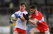13 January 2019; Darragh Canavan of Tyrone in action against Eoghan Concannon of Derry during the Bank of Ireland Dr McKenna Cup semi-final match between Tyrone and Derry at the Athletic Grounds in Armagh. Photo by Sam Barnes/Sportsfile