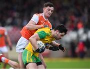 13 January 2019; Ryan McHugh of Donegal in action against Connaire Mackin of Armagh during the Bank of Ireland Dr McKenna Cup semi-final match between Donegal and Armagh at Healy Park in Tyrone. Photo by Oliver McVeigh/Sportsfile