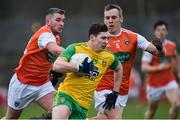 13 January 2019; Jamie Brennan of Donegal in action against Ryan McShane and Mark Shields of Armagh during the Bank of Ireland Dr McKenna Cup semi-final match between Donegal and Armagh at Healy Park in Tyrone. Photo by Oliver McVeigh/Sportsfile