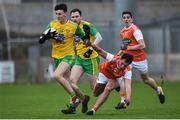 13 January 2019; Michael Langan of Donegal in action against Stephen Sheridan of Armagh during the Bank of Ireland Dr McKenna Cup semi-final match between Donegal and Armagh at Healy Park in Tyrone. Photo by Oliver McVeigh/Sportsfile