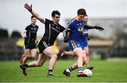 13 January 2019; Ronan Daly of Roscommon in action against Darragh Cummins of Sligo during the Connacht FBD League semi-final match between Roscommon and Sligo at Dr. Hyde Park in Roscommon. Photo by David Fitzgerald/Sportsfile