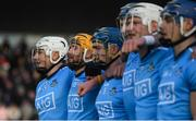 13 January 2019; Liam Rushe of Dublin and his teammates during the National Anthem ahead of the Bord na Mona Walsh Cup semi-final match between Dublin and Galway at Parnell Park in Dublin.  Photo by Ramsey Cardy/Sportsfile