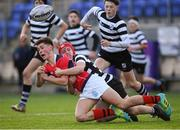 14 January 2019; Harry Lynch of Catholic University School is tackled by Blaine Barry of Cistercian College Roscrea during the Bank of Ireland Fr. Godfrey Cup Round 1 match between Catholic University School and Cistercian College Roscrea at Energia Park in Dublin. Photo by Harry Murphy/Sportsfile