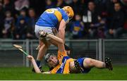 13 January 2019; Colin Guilfoyle of Clare in action against Padraic Maher of Tipperary during the Co-Op Superstores Munster Hurling League Final 2019 match between Clare and Tipperary at the Gaelic Grounds in Limerick. Photo by Piaras Ó Mídheach/Sportsfile